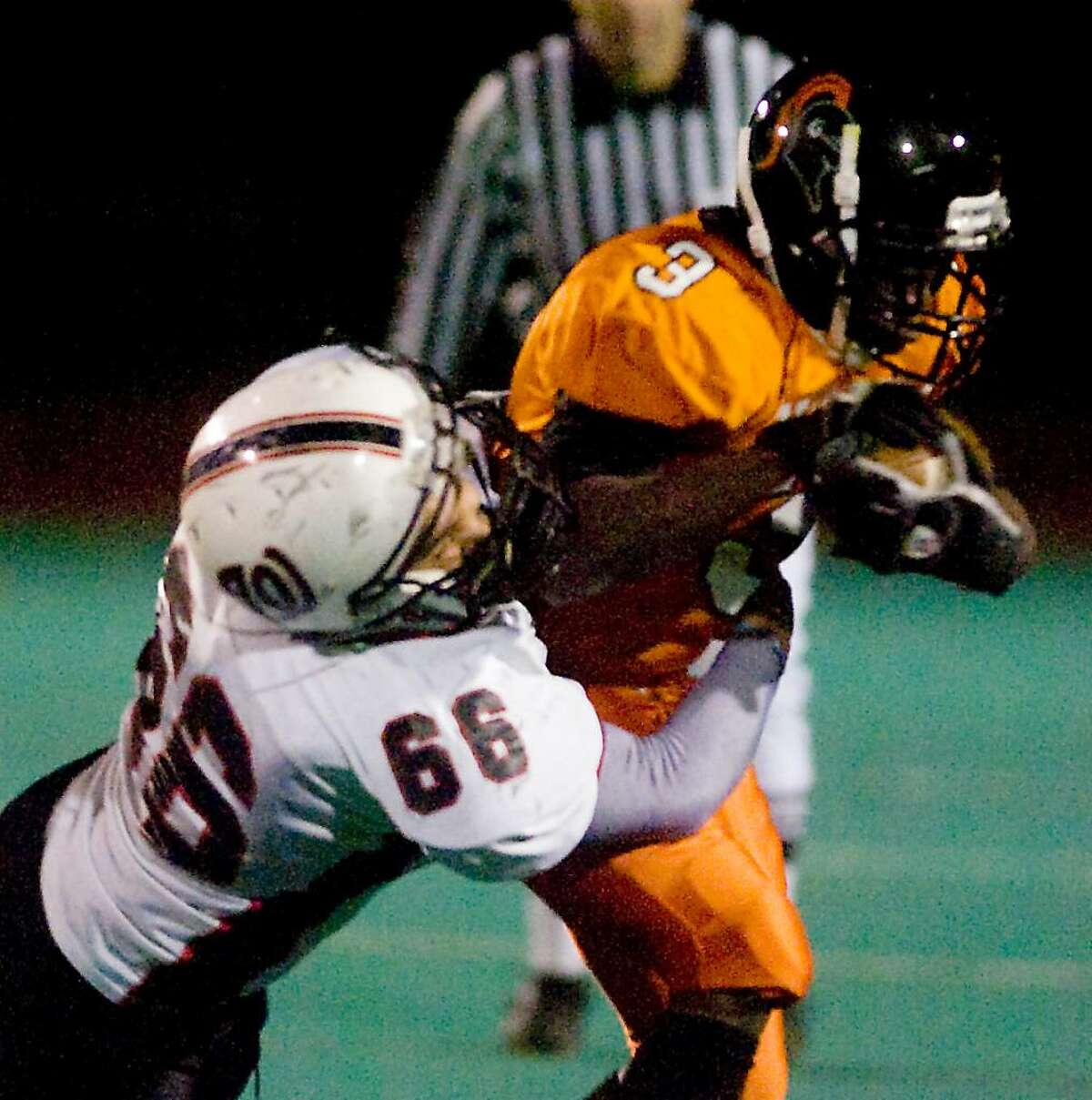 Stamford High's Mark Seward carries the ball against Fairfield Warde in football action in Stamford, Conn. on Friday, November 6, 2009.