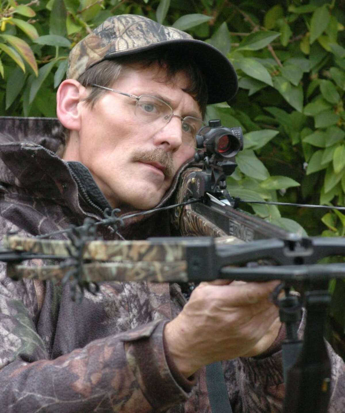Alfred Bouchard, of Brookfield, demonstrates cross bow hunting techniques at their home Thursday, Nov. 5, 2009.