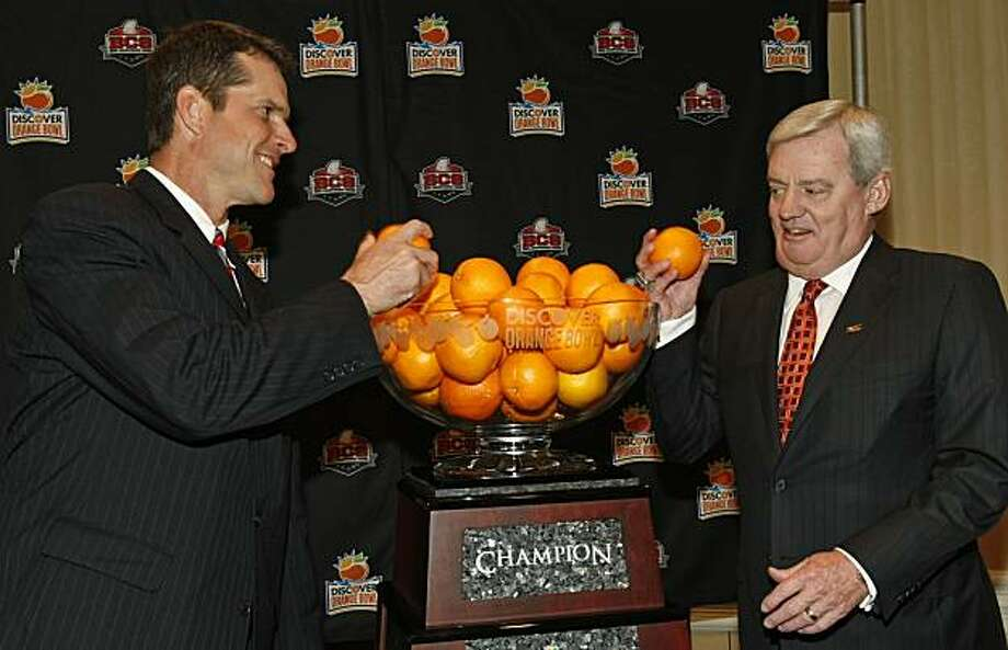 Stanford football head coach Jim Harbaugh, left, and Virginia Tech head coach Frank Beamer pose for a photo with the Orange Bowl during a coach's news conference in Ft. Lauderdale, Fla., Sunday,  Jan. 2, 2011.  Virginia Tech plays Stanford in the Orange Bowl NCAA college football game on Jan. 3, 2010. Photo: Hans Deryk, AP