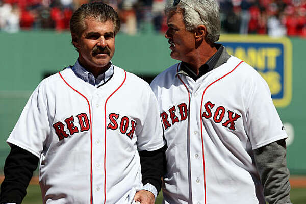 BOSTON - APRIL 08:  Former Boston Red Sox players Bill Buckner and Dwight Evans chat after Buckner threw out the ceremonial first pitch and Evans caught it before the game against the Detroit Tigers on April 8,2008 during Opening Day at Feway Park in Boston, Massachusetts.  (Photo by Elsa/Getty Images)