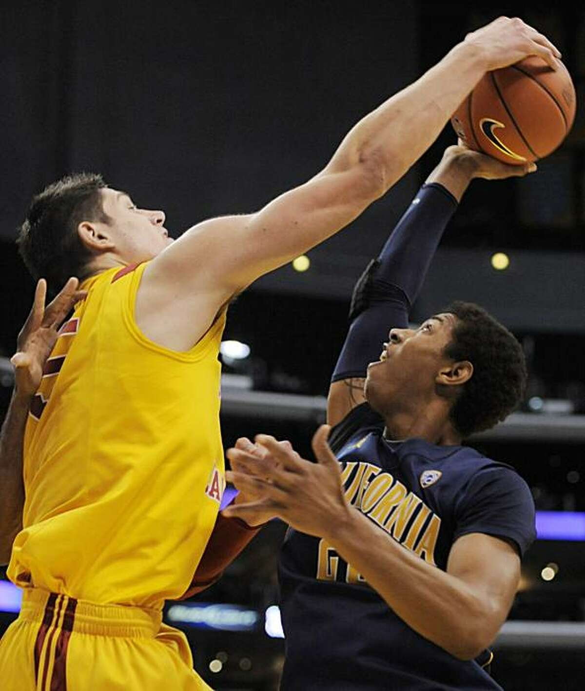 Southern California's Nikola Vucevic, left, blocks a shot by California's Richard Solomon during the second half of an NCAA college basketball game in the Pacific-10 tournament, Thursday, March 10, 2011, in Los Angeles. Southern California won the game, 70-56.