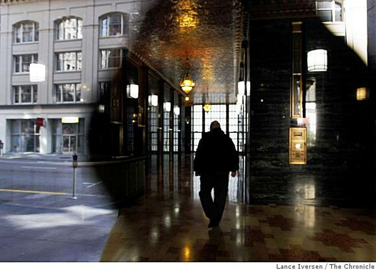 The neighboring building across the street from an old classic office tower at 140 New Montgomery at Minna Street is reflected in the window as night security guard Richard Thompson walks the lobby. Chronicle columnist Art Hoppe once wrote about this area in a series published in 1956,