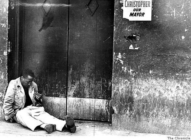 "A ""wino"" sits in a Skid Row doorway in San Francisco circa 1956. Chronicle reporter Art Hoppe began his series of stories that described his weeklong stay disguised as a bum on Skid Row. Photo: The Chronicle"
