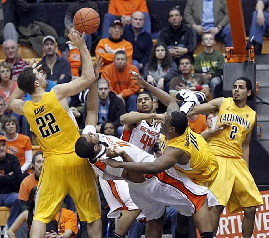 From left to right, California forward Harper Kemp, Oregon State's Joe Burton and Devon Collier and California's Markhuri Sanders-Frison and Jorge Gutierrez vie for a rebound during the second half of an NCAA college basketball game in Corvallis, Ore., Saturday, Feb., 26, 2011. California won 87-76. Photo: Don Ryan, AP