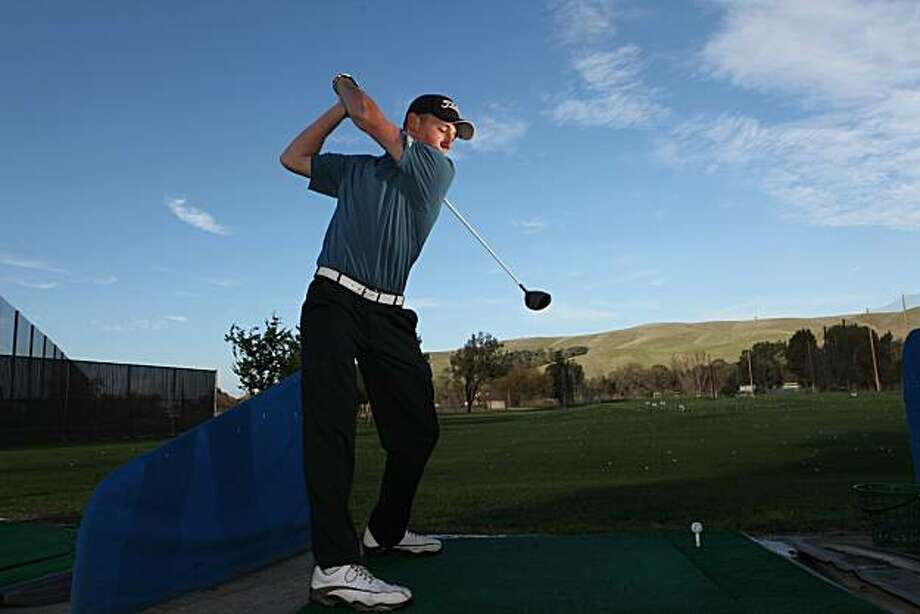 Clayton Valley High junior, Domenic Mazza, 16, practices his drive at Diablo Creek Golf Course in Concord, Calif. on Wednesday, December 15, 2010.   Mazza placed second in theWorld Long Drive Championship near Vegas last month then declined the $70,000 purse to remain an amateur athlete.  Kat Wade / Special to the Chronicle Photo: Kat Wade, Special To The Chronicle