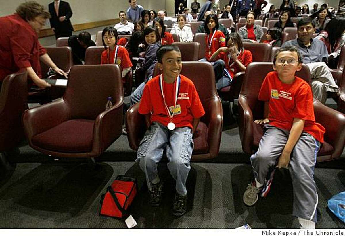 At Bank of America Center, 4th graders at Matsumoto Elementary School in San Jose, Ankith Iyengar, 10, and Sachin Deshpande (r), 10, wear their awards around their necks during the Stock Market Game awards ceremony on Tuesday May 12, 2009 in San Francisco, Calif.