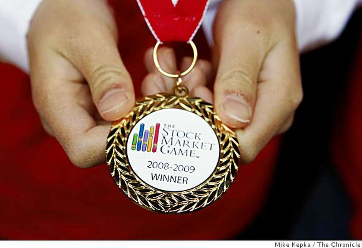 At Bank of America Center, Anthony Wong, 9, 4th grader from Matsumoto Elementary School in San Jose, holds his award from this years The Stock Market game on Tuesday May 12, 2009 in San Francisco, Calif.
