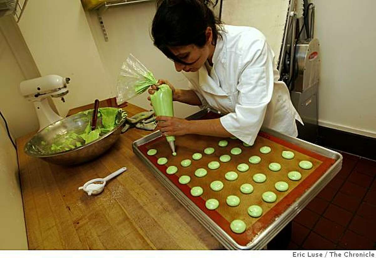 Bakery Chef Owner Kelli Manukyan uses a pastry bag while making Macarons at Pamplemousse Patisserie and Cafe in Redwood City photographed on Wednesday, April 29, 2009.