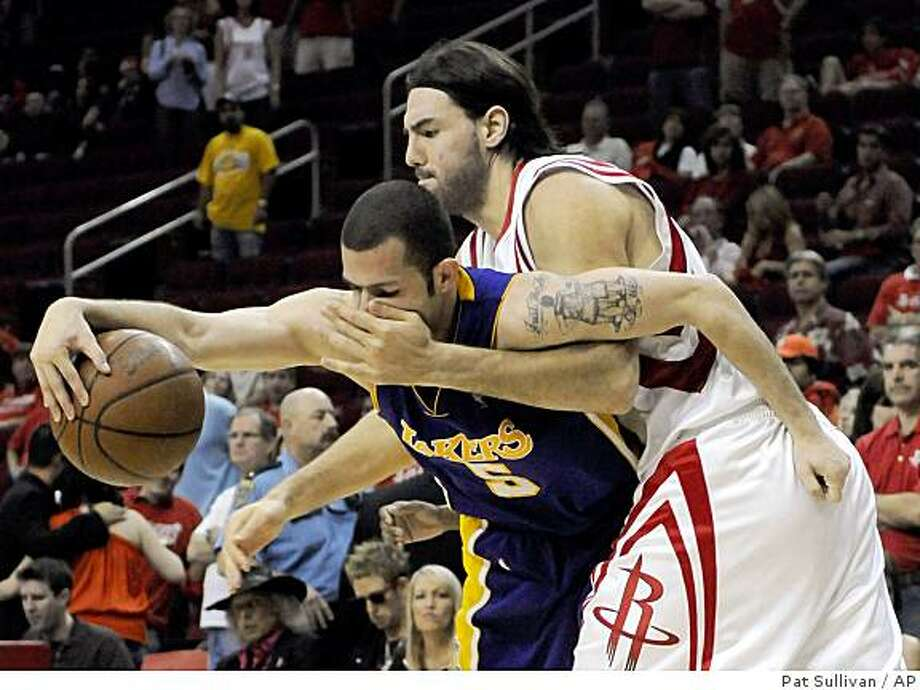 Los Angeles Lakers' Jordan Farmar (5) is fouled by Houston Rockets' Luis Scola, of Argentina, during the second half of Game 3 of a second round Western Conference NBA playoff basketball game Friday, May 8, 2009 in Houston. The Lakers won 108-94. (AP Photo/Pat Sullivan) Photo: Pat Sullivan, AP