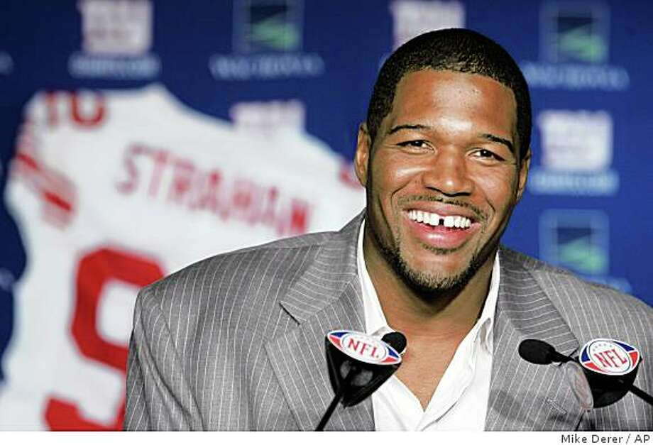 ** FILE ** In this June 10, 2008 file photo, New York Giants Michael Strahan talks about his retirement from football during a news conference at Giants Stadium in East Rutherford, N.J.  Strahan has the New York Giants waiting again. A year after making them wait an entire training camp on a retirement decision, No. 92 has the Super Bowl champions waiting to see if he will come out of retirement. (AP Photo/Mike Derer) Photo: Mike Derer, AP