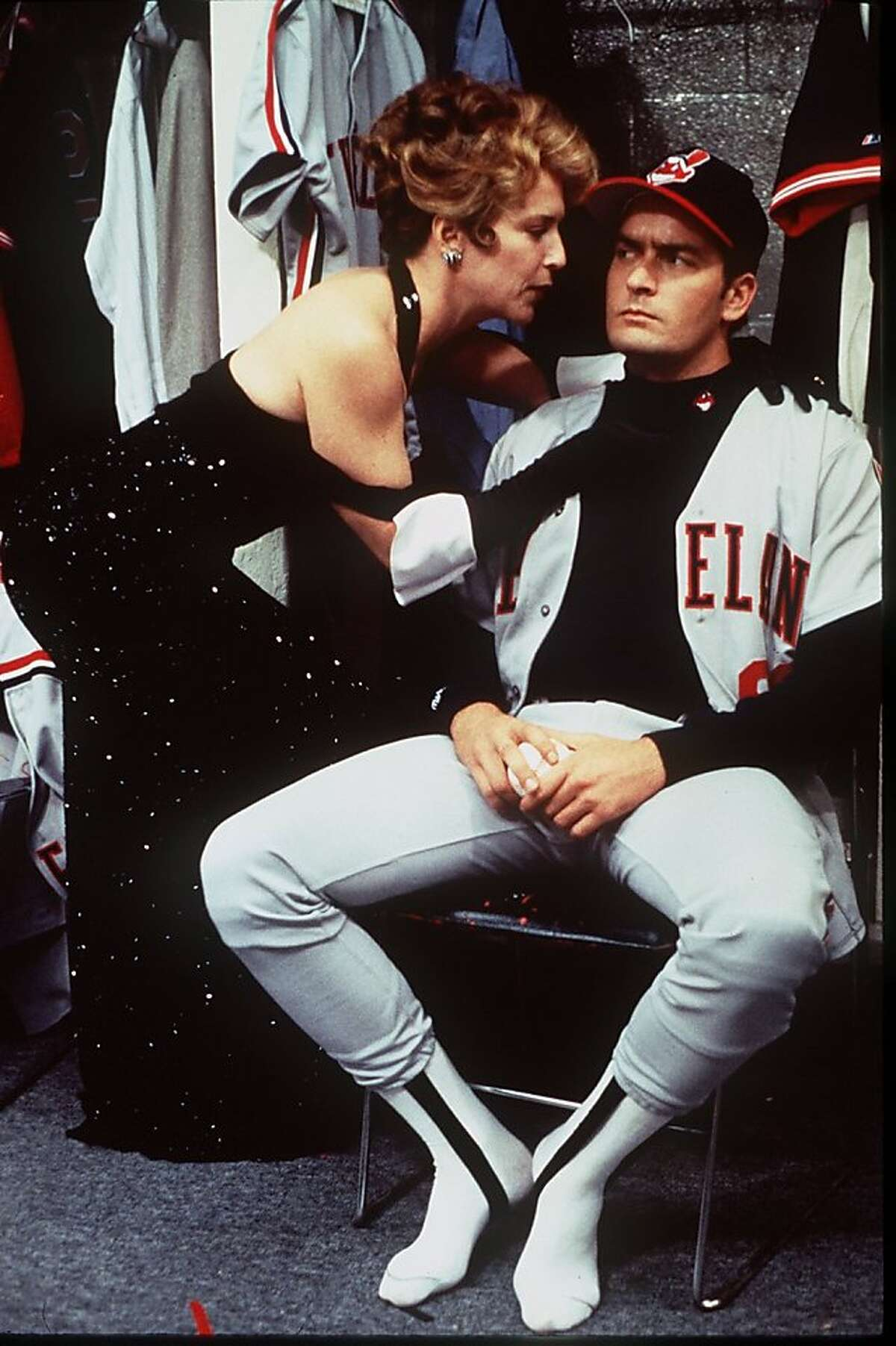 Cleveland Indians team owner Rachel Phelps (Maragaret Whitton) gives her version of a pep talk to pitcher Rick Vaughn (Charlie Sheen) in the 1989 movie