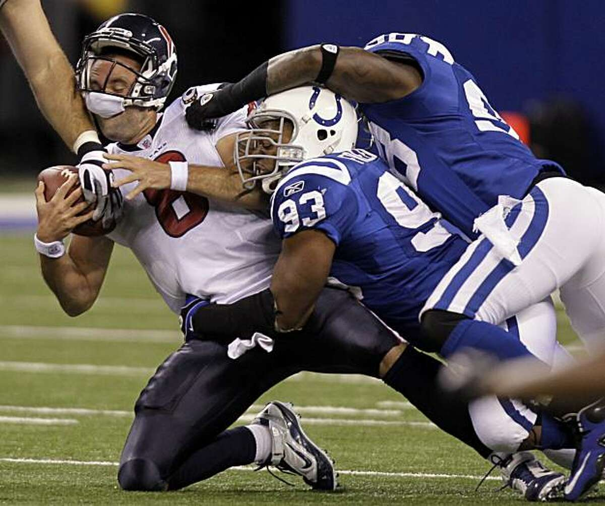 Houston Texans quarterback Matt Schaub, left, is sacked by Indianapolis Colts' Dwight Freeney (93) and Robert Mathis in the first quarter of an NFL football game in Indianapolis, Monday, Nov. 1, 2010.