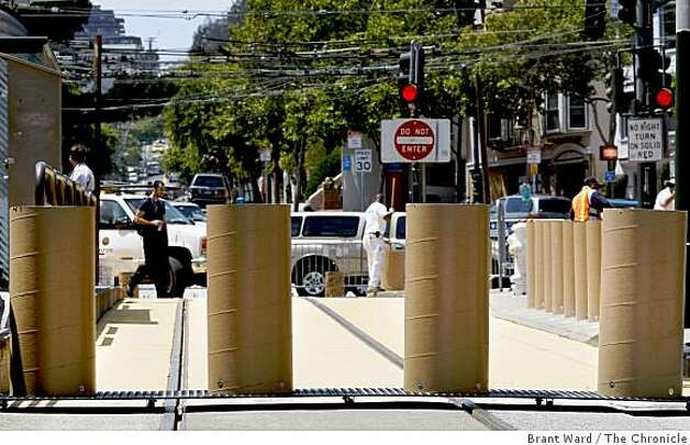 A series of tall planters, which can be rolled out of the way for emergency vehicles, will block cars from entering the plaza. A small stretch of 17th Street near Castro will be turned into a trial pedestrian plaza, and a no-car zone. Photo: Brant Ward, The Chronicle