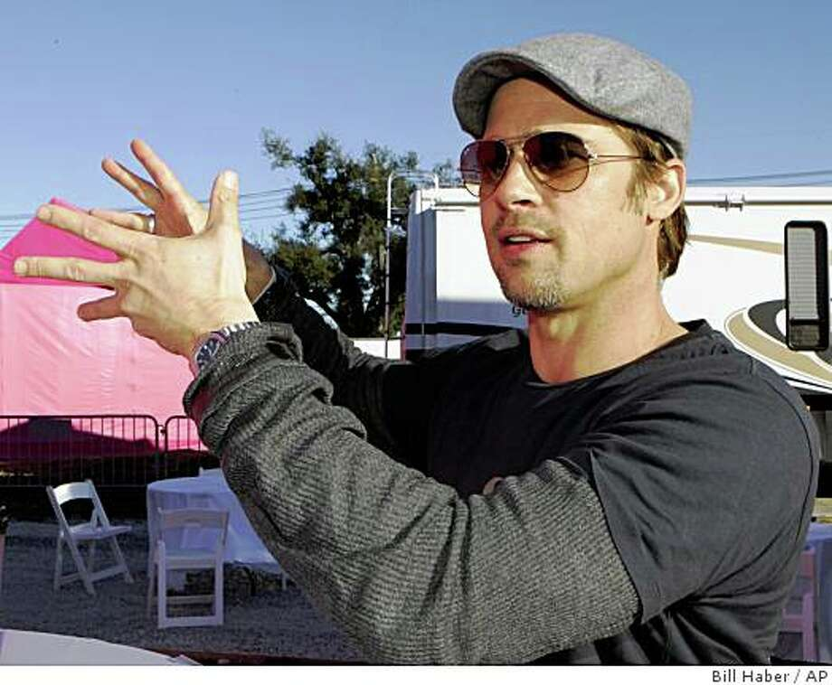 Actor Brad Pitt talks about his plan to build homes in the Lower 9th Ward in New Orleans, Monday, Dec. 3, 2007. Pitt is launching his latest project to build affordable, environmentally friendly homes in the area devastated by Hurricane Katrina. (AP Photo/Bill Haber) Ran on: 12-17-2007 Brad Pitt says he has no acting projects under way because he wants to work on post-Hurricane Katrina recovery efforts in New Orleans. Photo: Bill Haber, AP