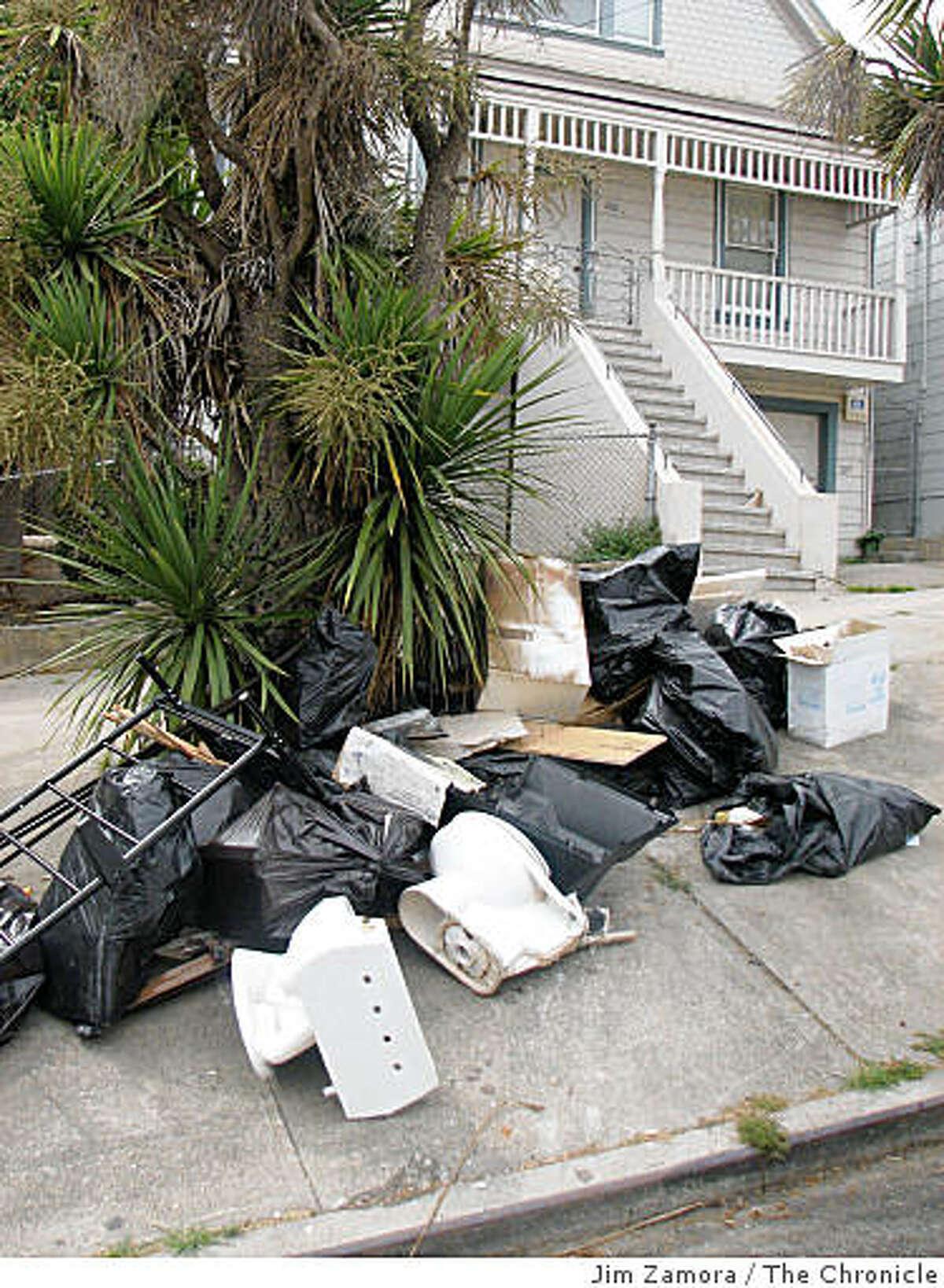 Trash dumped on an S.F. sidewalk in 2007.