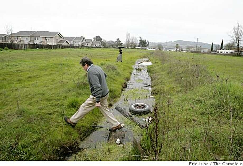 The discovery of a tiger salamander in 2005 in the old refrigerator pictured in this drainage ditch put the Cobblestone Homes housing development on hold. Photo: Eric Luse, The Chronicle