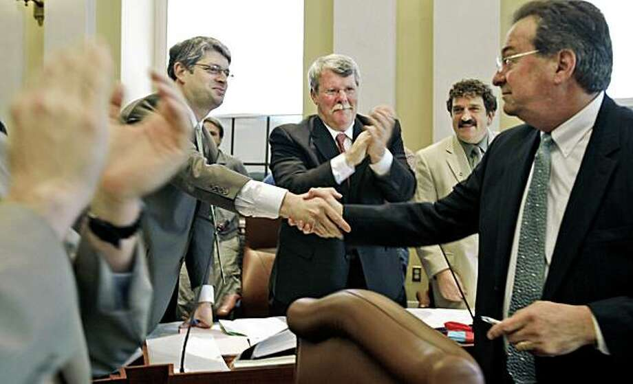 Sen. Lawrence Bliss, D- South Portland, right, is congratulated by fellow lawmakers in the Senate chamber after they voted and gave final approval to a gay rights marriage bill at the State House in Augusta, Maine, on Wednesday, May 6, 2009. Senators are, at  left, Joseph Perry, D-Bangor, Dennis Damon, D-Trenton, center, and Bruce Bryant, D-Dixfield. Maine's Gov. John Baldacci later signed the bill. ( AP Photo/Pat Wellenbach) Photo: Pat Wellenbach, AP