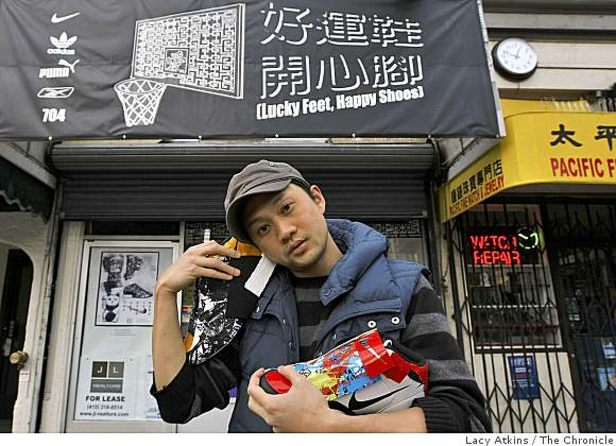 Ken Lo, 30, stands in front of a vacant storefront that he transformed into an art exhibit, Thursday, April 30, 2009, in San Francisco, Calif.