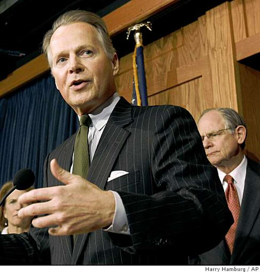Rep. David Dreier R-Calif., flanked by Rep. Shelley Moore Capito R-W.Va., left, and Rep. Mike Castle R-Del., gestures during a news conference on Capitol Hill in Washington, Wednesday, March 25, 2009, to discuss the budget. (AP Photo/Harry Hamburg) Photo: Harry Hamburg, AP