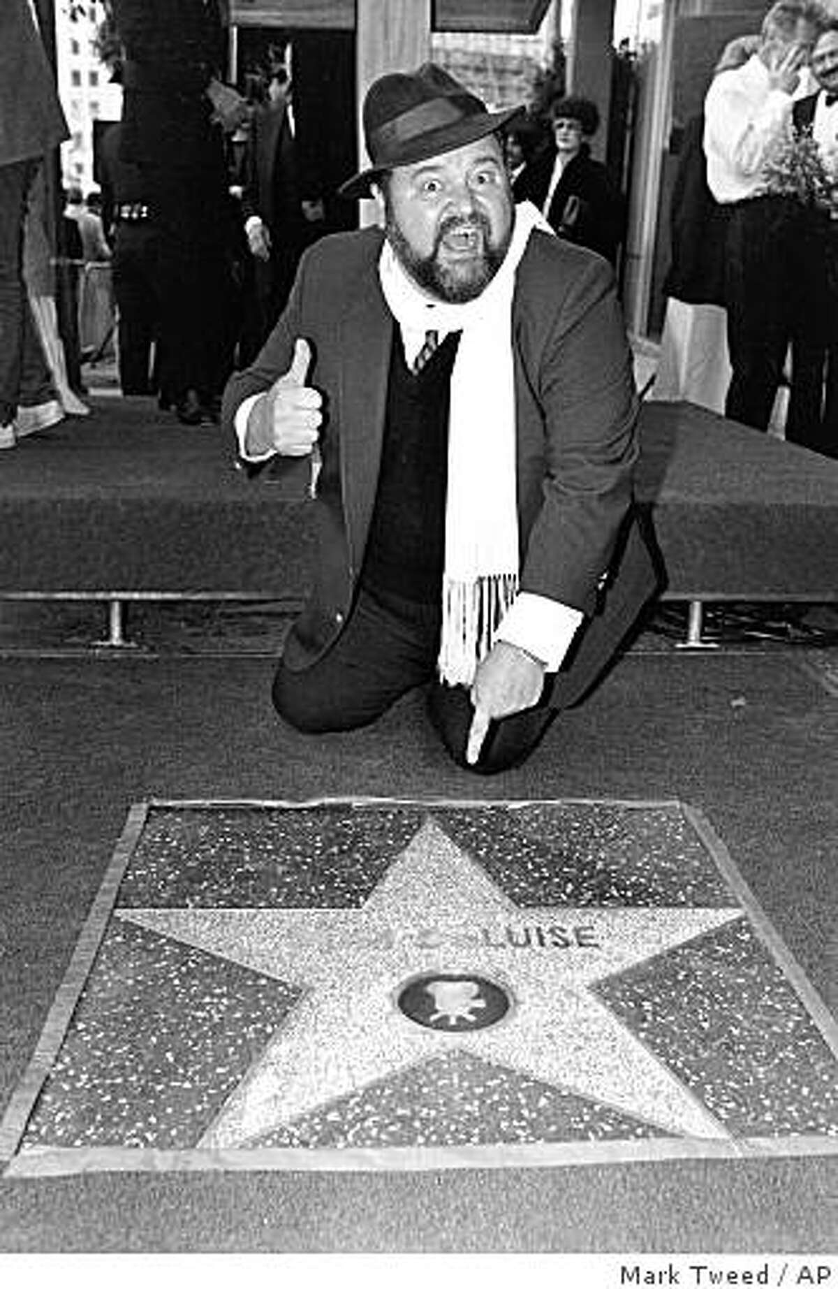 In this May 7, 1985 file photo, actor Dom DeLuise points to his star on the Hollywood Walk of Fame. DeLuise died in Southern California on Monday, May 4, 2009, according to his son, Michael DeLuise. He was 75.