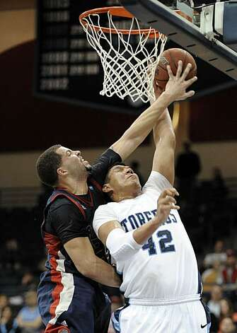 Saint Mary's Rob Jones, left, blocks a shot by San Diego's Chris Gabriel, right, during the first half of an NCAA college basketball game Wednesday, Feb. 16, 2011, in San Diego. Photo: Denis Poroy, AP