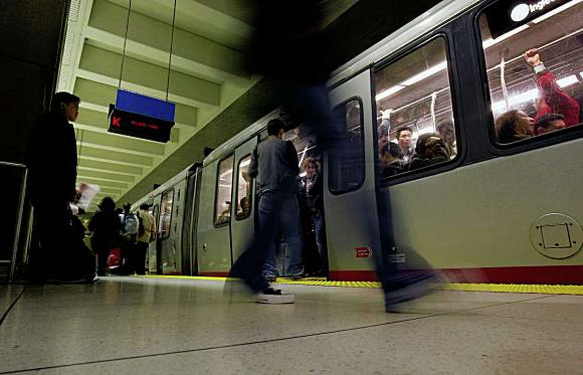 Commuters leave and board a MUNI train at the Van Ness Street station in San Francisco, Calif., on Friday, February 20, 2009. Attempts to get more people out of their cars have fallen short, despite strong arguments from advocates who say alternatives to driving are good for the environment.
