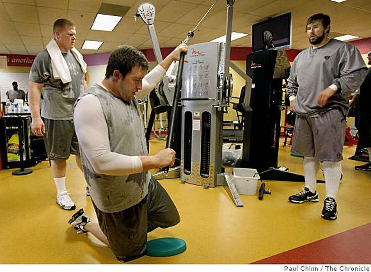 Joe Staley (center) works out with teammates Tony Wragge (left) and Adam Snyder (right) in the new expanded weight room at the 49ers training facility in Santa Clara, Calif., on Tuesday, April 14, 2009.