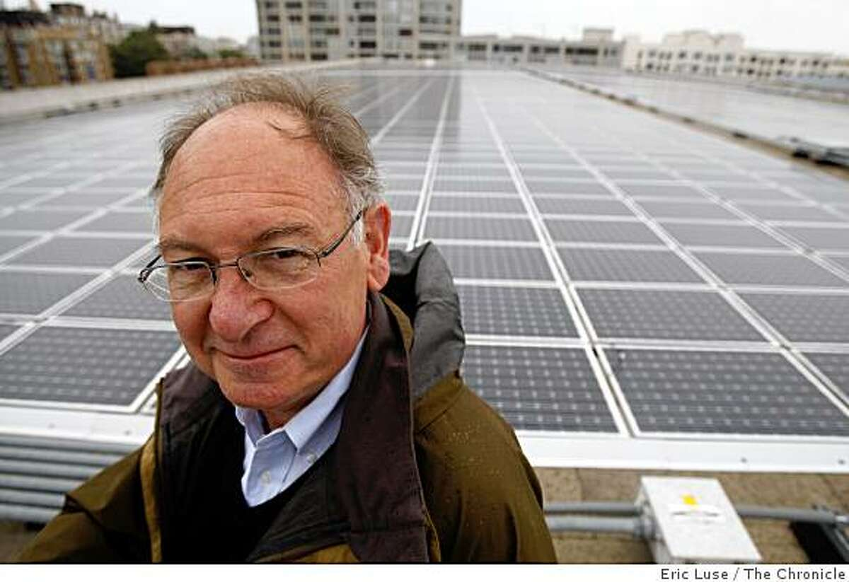 Utility Specialist James Andrews on the roof of the Moscone Center's huge solar panel project photographed in San Francisco on Friday, May 1, 2009.