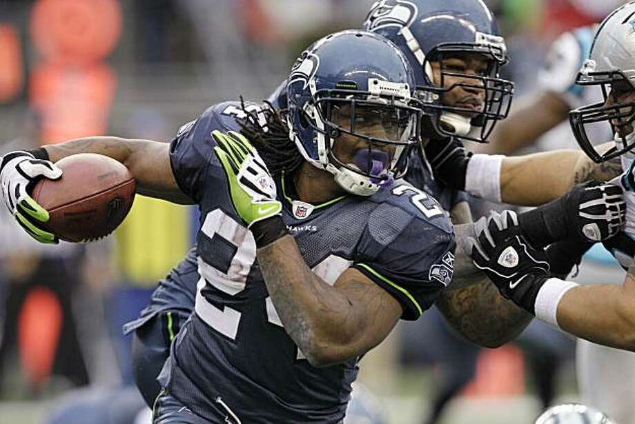 Seattle Seahawks' Marshawn Lynch (24) rushes against the Carolina Panthers in the second half of an NFL football game, Sunday, Dec. 5, 2010 in Seattle. The Seahawks won 31-14. Photo: Elaine Thompson, AP