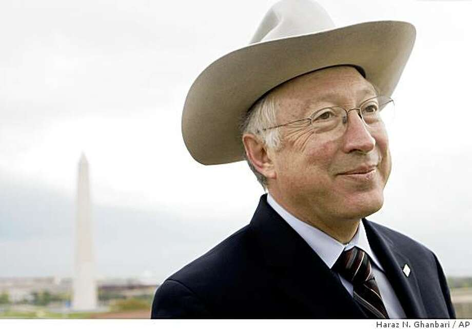 With the Washington Monument looming at left, Interior Secretary Ken Salazar talks with a park employee following a news conference at the Interior Department in Washington, Wednesday, April 22, 2009. (AP Photo/Haraz N. Ghanbari) Photo: Haraz N. Ghanbari, AP
