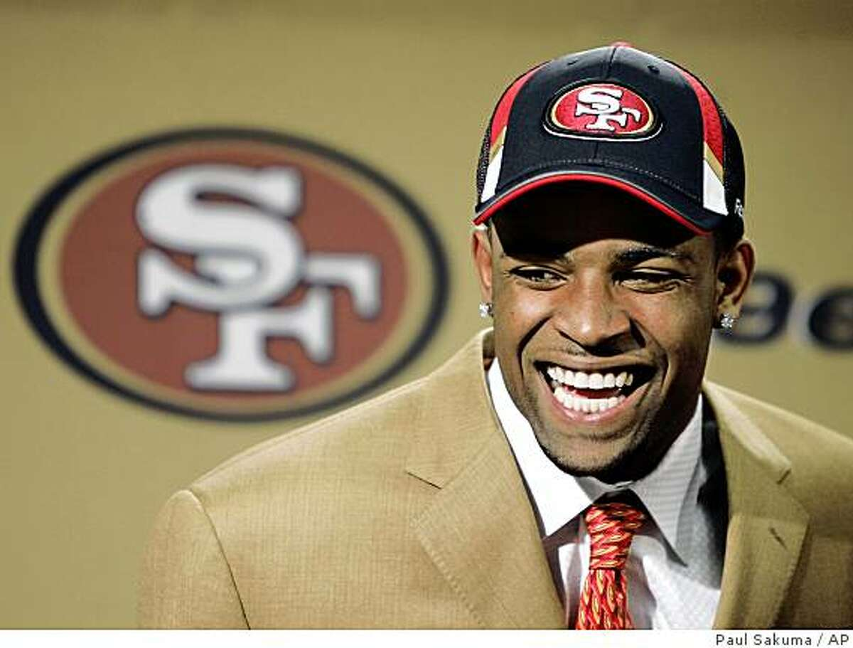 Michael Crabtree, the San Francisco 49ers' first-round draft pick, laughs during a news conference at team headquarters in Santa Clara on Sunday.