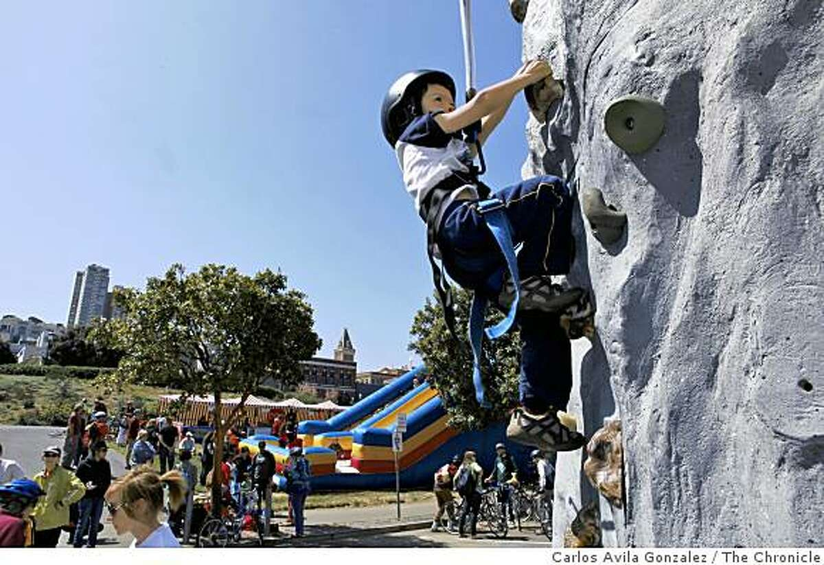 Ronin Mukai, 5, of San Francisco, tries out the climbing wall at the end of Fisherman's Wharf on Sunday, April 26, 2009, that was part of the first Sunday Streets event for 2009. The event shut down the Embarcadero from about 9 a.m. to 1 p.m. from the ballpark to Fishermans' Wharf in San Francisco, Calif.