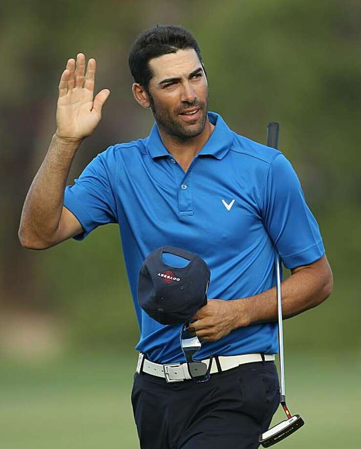 DUBAI, UNITED ARAB EMIRATES - FEBRUARY 13:  Alvaro Quiros of Spain celebrates during the final round for the 2011 Omega Dubai desert Classic held on the Majilis Course at the Emirates Golf Club on February 13, 2011 in Dubai, United Arab Emirates. Photo: Ian Walton, Getty Images