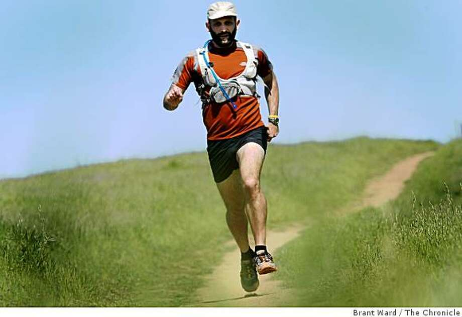 Tony prefers trail runs. Here he runs at Arastradero Preserve near Palo Alto, CA. Tony Dunnigan, 36, of Palo Alto started running to stay in shape. Now he is training for a 200 mile run from Calistoga to Santa Cruz the first of May, 2009. Photo: Brant Ward, The Chronicle