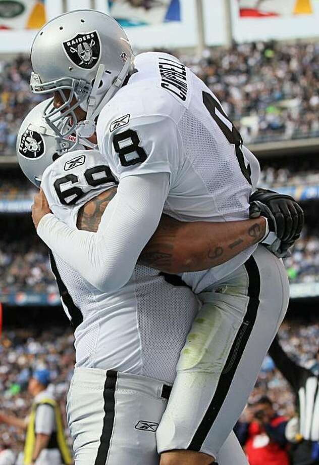 SAN DIEGO - DECEMBER 05:  Quarterback Jason Campbell #8 the Oakland Raiders is congratulated by teammate Khalif Barnes #69 after scoring a touchdown against the San Diego Chargers during the first quarter at Qualcomm Stadium on December 5, 2010 in San Diego, California. The Raiders defeated the Chargers 28-13. Photo: Jeff Gross, Getty Images