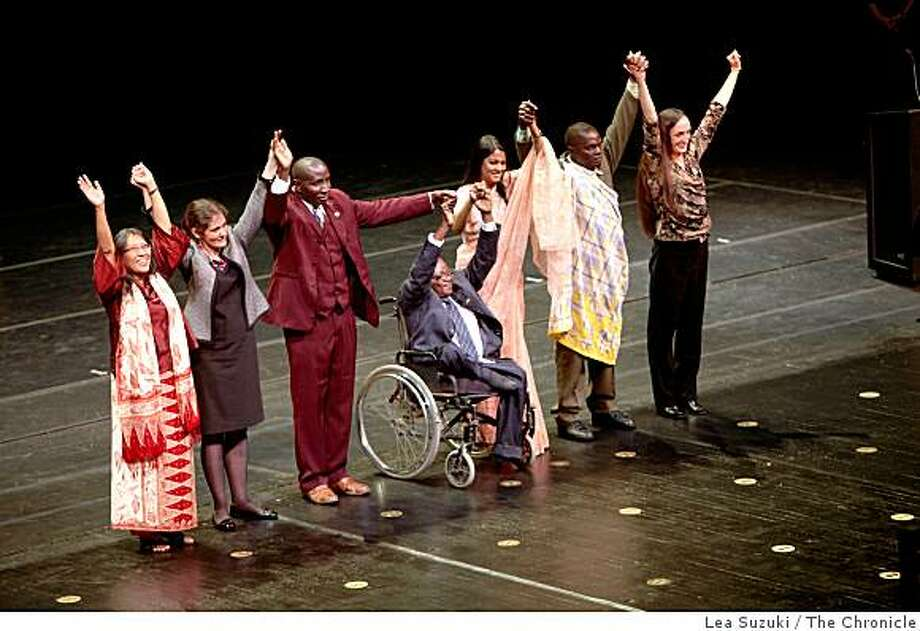 Yuyun Ismawati (l to r), Olga Speranskaya, S. Hugo Jabini, Marc Ona Essangui, Syeda Rizwana Hasan, Wanze Edwards and Maria Gunnoe raise hands and bow after taking the stage together at the end of the 20th anniversary ceremony of the Goldman Environmental Prize at the War Memorial Opera House in San Francisco, Calif. on Monday April 20, 2009. Photo: Lea Suzuki, The Chronicle