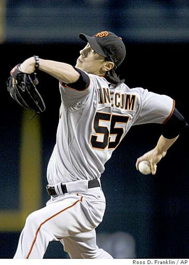 San Francisco Giants' Tim Lincecum throws against the Arizona Diamondbacks in the first inning Friday in Phoenix. Photo: Ross D. Franklin, AP
