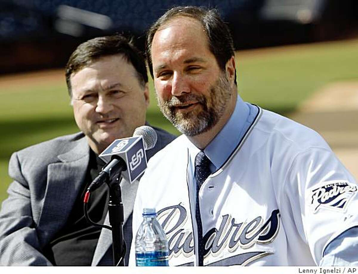 Jeff Moorad, right, and John Moores laugh as Moorad refuses to name all his partners involved in the purchase of the the San Diego Padres baseball team from Moores, at a news conference at Petco Park on Thursday, March 26, 2009, in San Diego. Moorad's group has taken control of approximately 35 percent of the club and expects to own it all within five years. (AP Photo/Lenny Ignelzi)