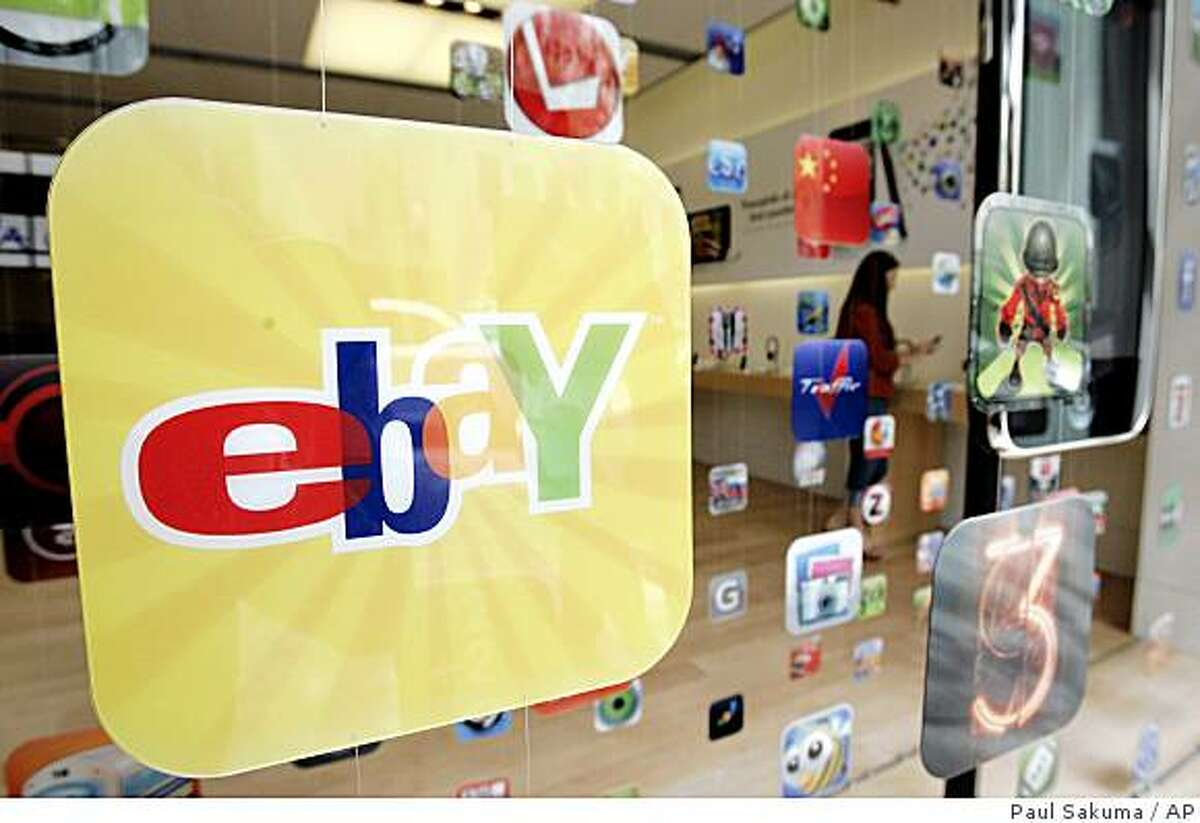 In this April 21, 2009 photo, a display advertising the eBay application for iPhone and iPod is shown at an Apple store in Palo Alto, Calif. EBay Inc. and Apple Inc. report quarterly earnings after the closing bell Wednesday. (AP Photo/Paul Sakuma)