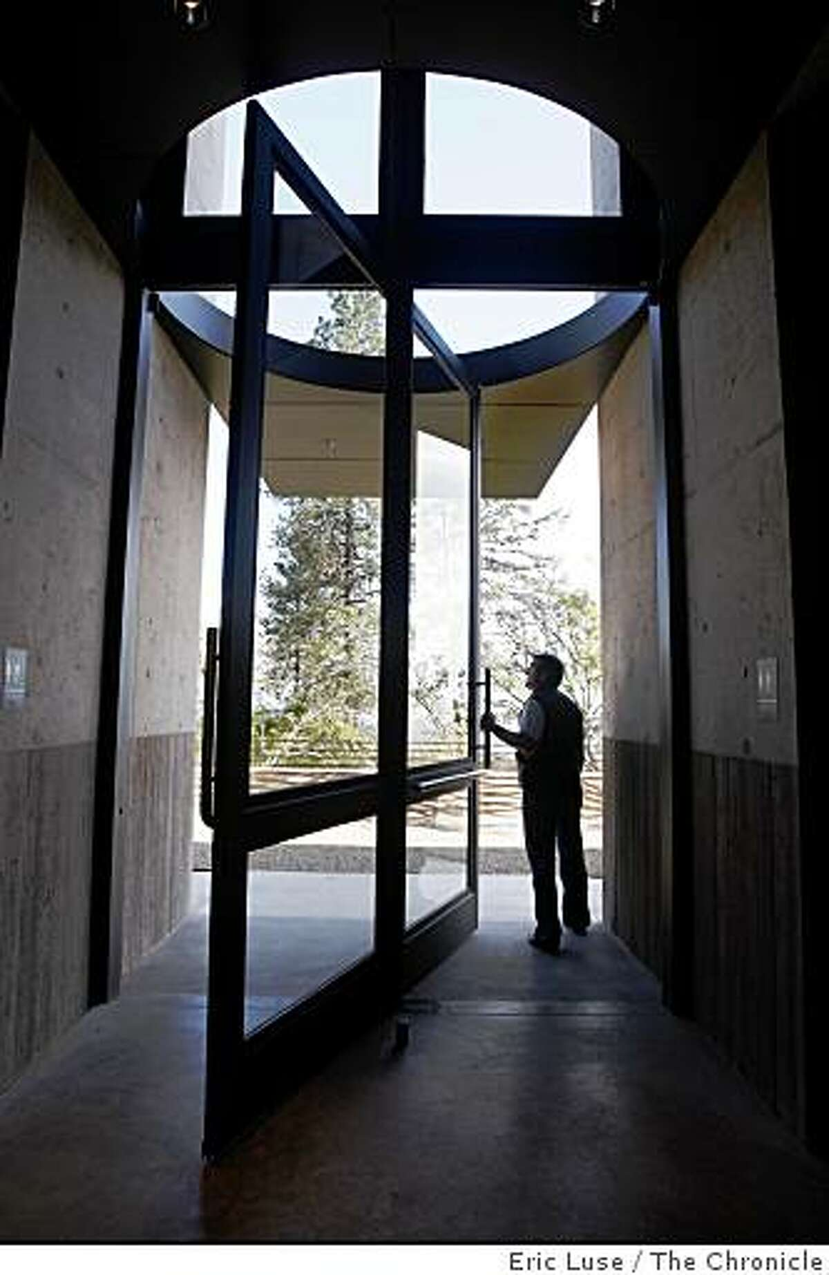 Dramatic oversized swing door at the entrance to Cade WInery which is up against a hillside photographed in Napa on Tuesday, April 14, 2009.