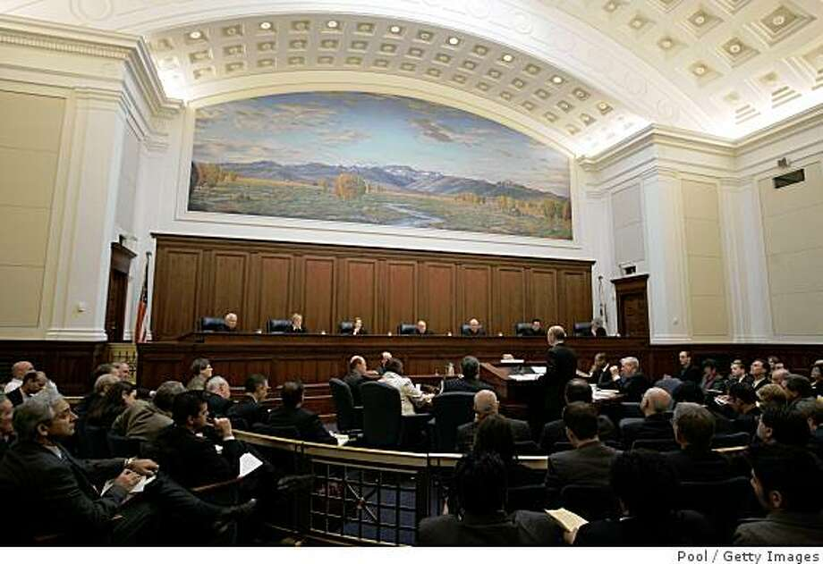 SAN FRANCISCO - MARCH 5:  Shannon Minter, standing, speaks to the California Supreme Court Justices inside the California Supreme Courtroom as arguments for and against proposition 8 on March 5, 2009 in San Francisco, California. The arguments are on lawsuits seeking to overturn Proposition 8, the state's voter-approved ban on same-sex marriage.  (Photo by Paul Sakuma-Pool/Getty Images) Photo: Pool, Getty Images