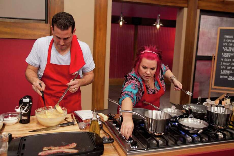 Anthony Schiano of New York and Dorothy Strouhal of Cove, Tx. in Chambers County, get serious in the kitchen as they compete in the Food Network's Worst Cooks in America. The third season -- staring chefs Bobby Flay and Anne Burrell -- premieres Sunday, Feb. 12. Photo: Food Network Photo / © 2011, Television Food Network, G.P.
