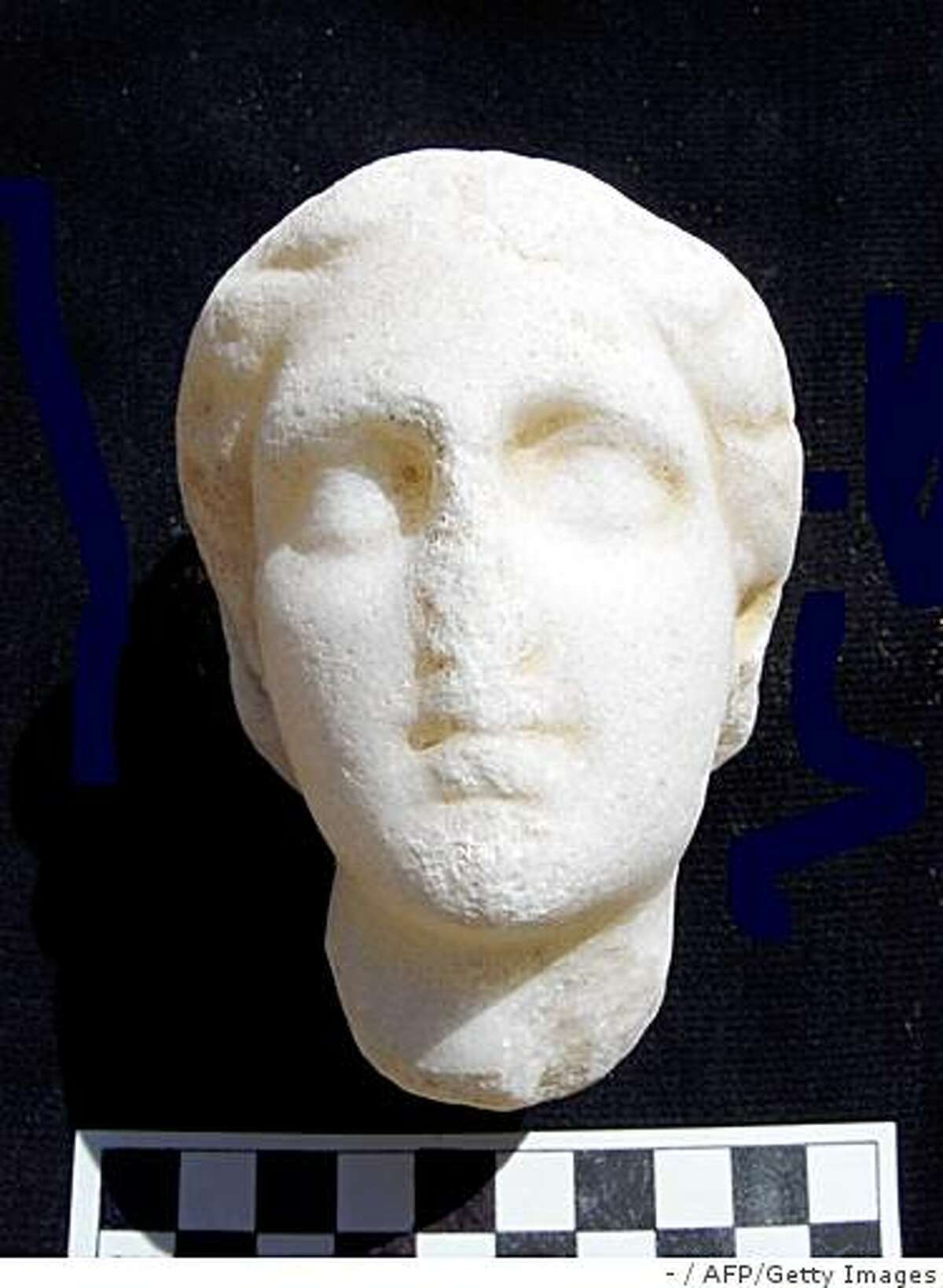 A recent undated handout picture from the Egyptian Supreme Council of Antiquities shows a newly discovered carved head of Cleopatra at the Taposiris Magna temple, West of Alexandria. An archaeological team from Egypt and the Dominican Republic completed a three-year radar survey of Taposiris Magna as part of the search for the tomb of Cleopatra and Mark Antony, according to to the SCA in a press statement released on April 15, 2009. AFP PHOTO/HO/EGYPTIAN SUPREME COUNCIL OF ANTIQUITIES == RESTRICTED TO EDITORIAL USE == (Photo credit should read -/AFP/Getty Images)