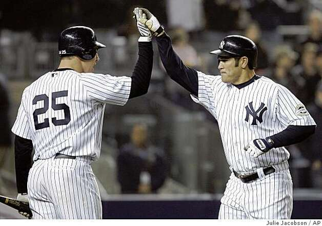 New York Yankees' Johnny Damon, right, is greeted by Mark Teixeira after hitting a solo home run in the sixth inning against the Oakland Athletics during a baseball game Tuesday, April 21, 2009, at Yankee Stadium in New York. (AP Photo/Julie Jacobson) Photo: Julie Jacobson, AP