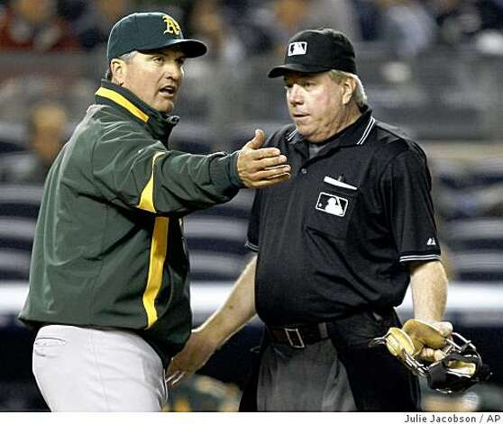 Oakland Athletics manager Bob Geren, left, argues a call by home plate umpire Brian Gorman in which Gorman called Eric Chavez out for running out of the baseline in the fourth inning against the New York Yankees during a game Tuesday, April 21, 2009, at Yankee Stadium in New York. Photo: Julie Jacobson, AP