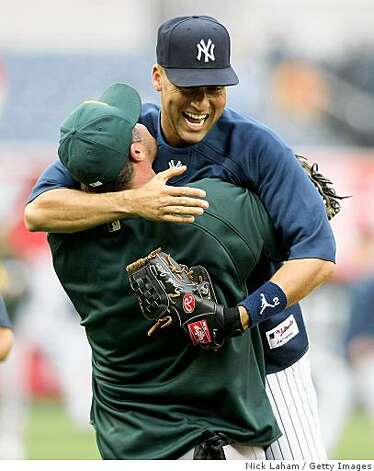 Derek Jeter is embraced by former teammate Jason Giambi at Yankee Stadium April 21, 2009 in the Bronx . Photo: Nick Laham, Getty Images
