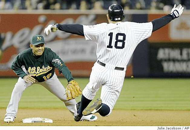 Oakland Athletics shortstop Orlando Cabrera reaches to put the tag on New York Yankees' Johnny Damon who tried to stretch a base hit to center field into a double in the second inning of a baseball game Tuesday, April 21, 2009, at Yankee Stadium in New York. Brett Gardner scored on the hit. Photo: Julie Jacobson, AP