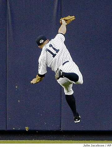 New York Yankees' Brett Gardner makes a leaping catch on a ball hit deep to center field by Oakland Athletics' Jason Giambi in the first inning of a game Tuesday, April 21, 2009, at Yankee Stadium in New York. Photo: Julie Jacobson, AP