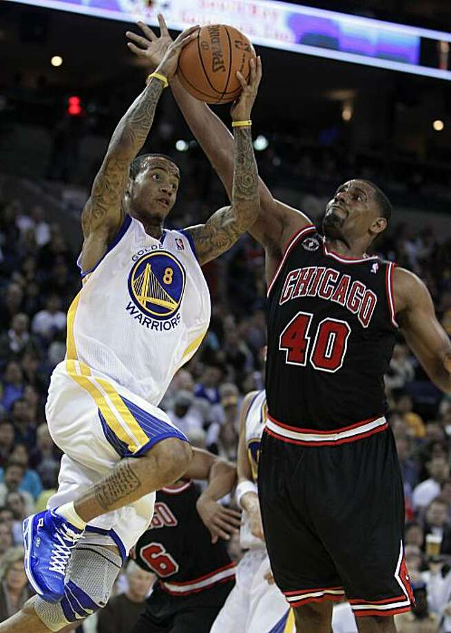 Golden State Warriors' Monta Ellis, left, goes up for a shot against Chicago Bulls'  Kurt Thomas during the second half of an NBA basketball game Saturday, Feb. 5, 2011, in Oakland, Calif. Photo: Ben Margot, AP