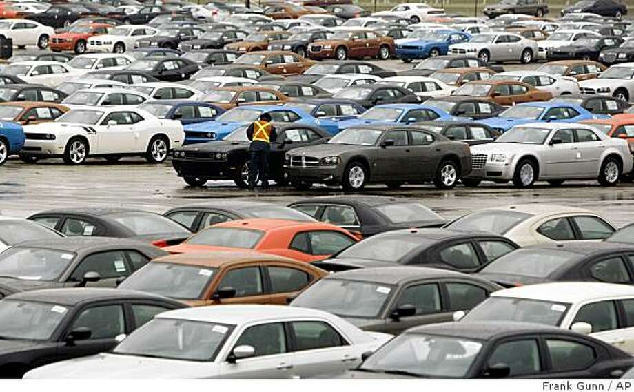 A Lot Attendant Inspects One Of Hundreds Chrysler Cars Sitting Ready For Final Embly And